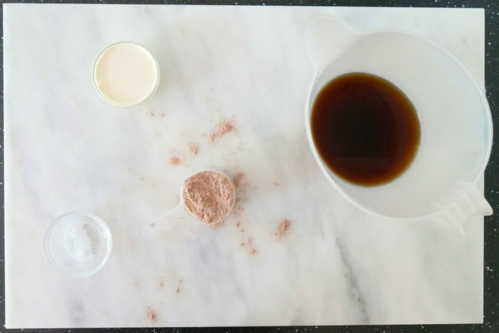 Coffee, protein powder, Stevia and double cream on a marble surface ready for a high protein coffee