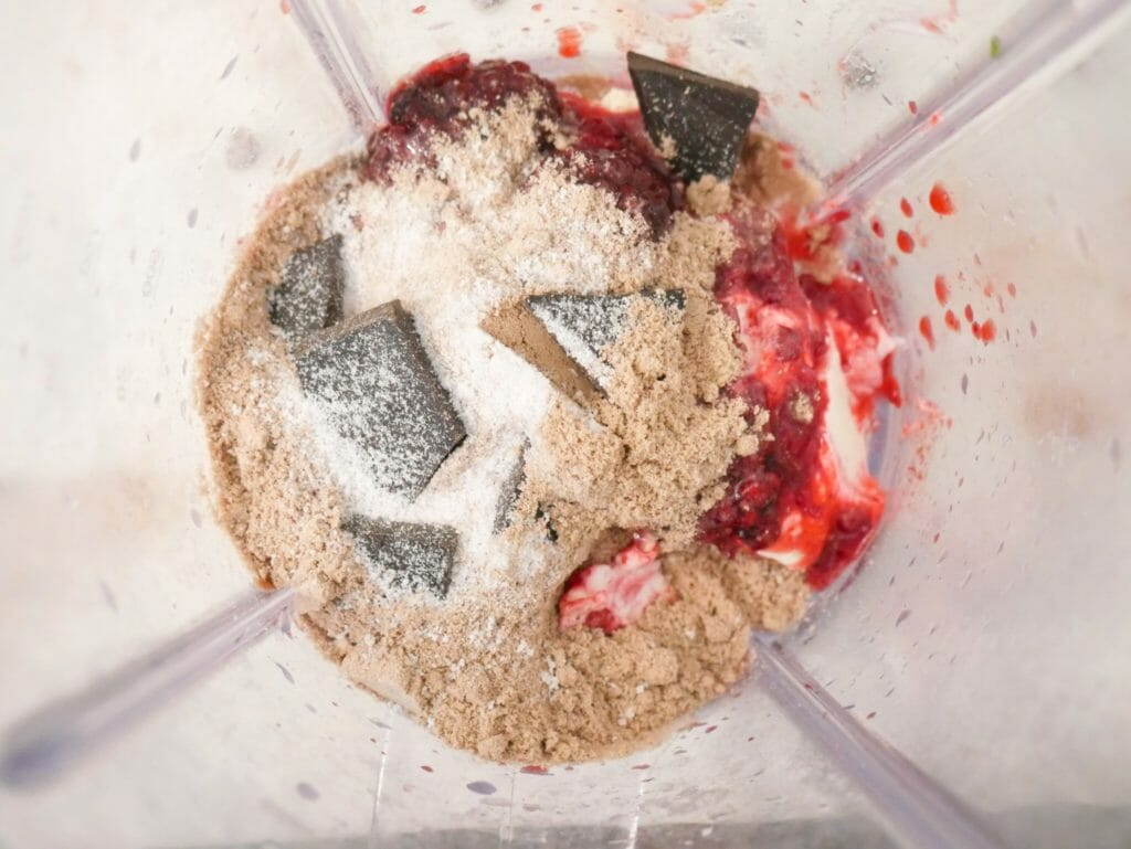 Mixed berry protein smoothie ingredients in a blender