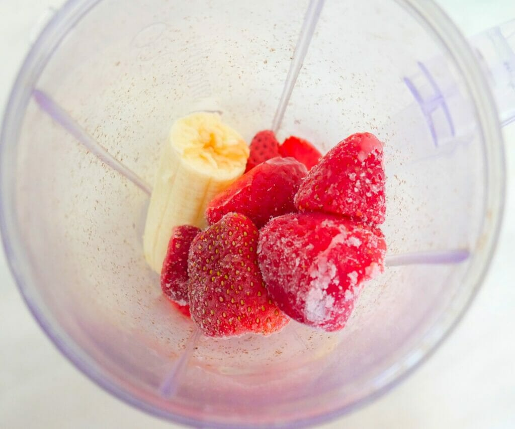 Banana and strawberries in a blender