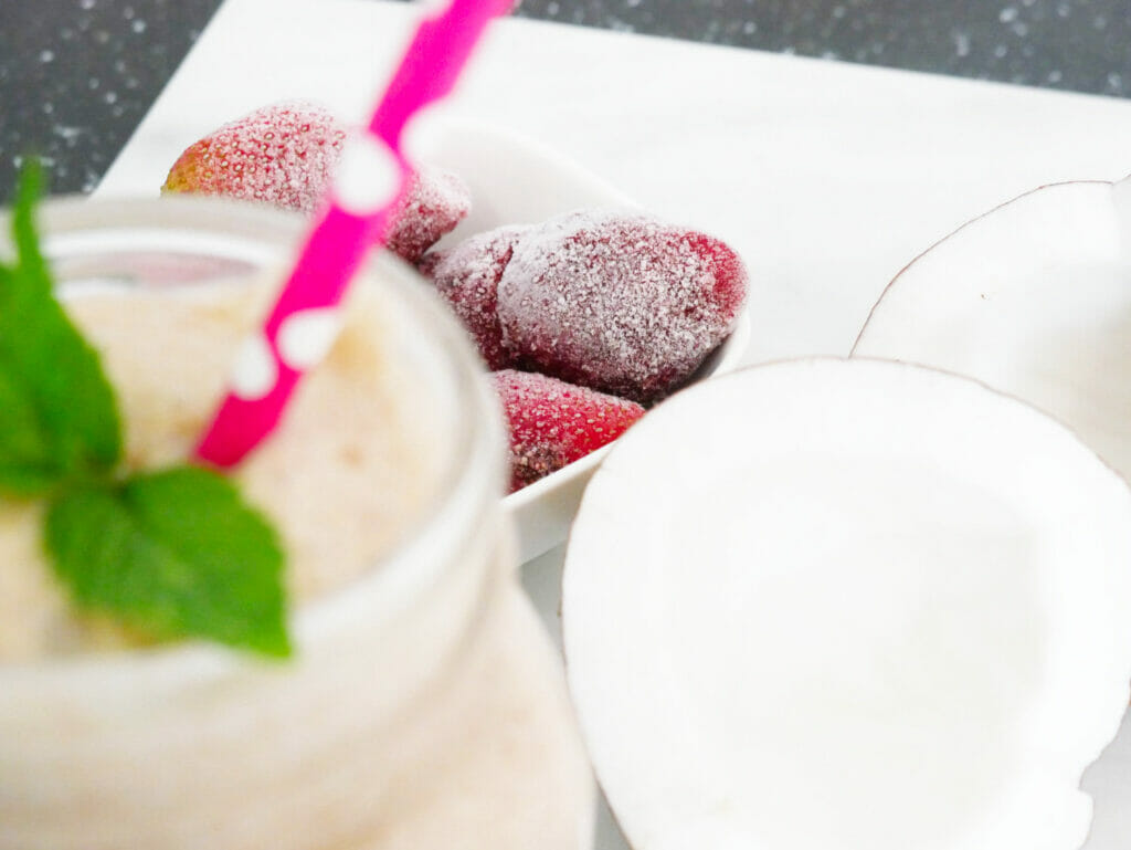 Healthy strawberry smoothie with coconut open